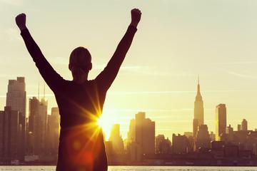 158064_successful-woman-sunrise-new-york-city-skyline-000079384959_large