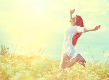 182585_girl-in-white-dress-jumping-on-summer-field-with-blooming-wild-flowers-e1461864145755