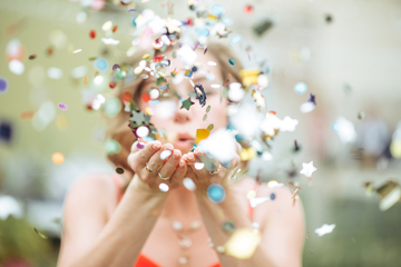 384867_girl blowing confetti