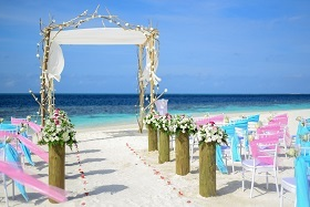 472289_canva - beach wedding under blue sky