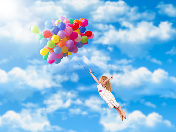 510107_the-little-girl-holding-balloons-fly-hd-picture