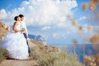 2497_16986724-happy-couple-wedding-walk-at-mountains-near-the-sea-series-stock-photo