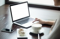 42088_woman-with-laptop-on-a-wooden-table_1163-54